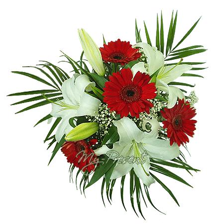 Blumenstrauß aus Lilien und Germinis geschmückt mit Farn